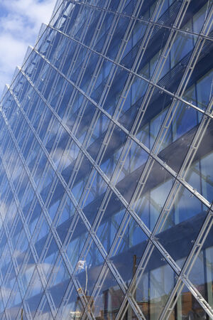 Modern Glass Building Reflecting Blue Sky