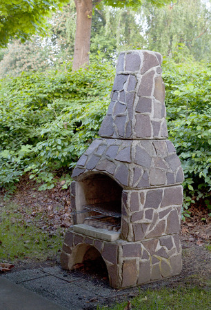 Outdoor Fireplace in Garden photo