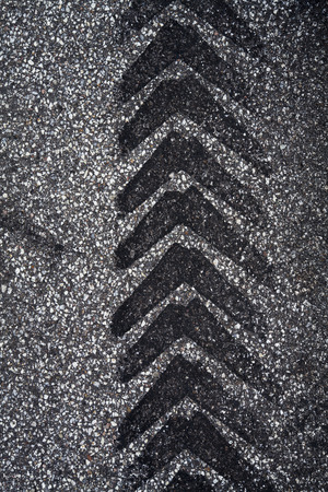 Tire Track on Asphalt photo