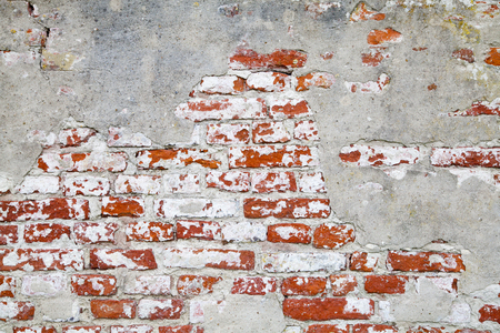 Old Red Brick Wall with Cracked Concrete photo