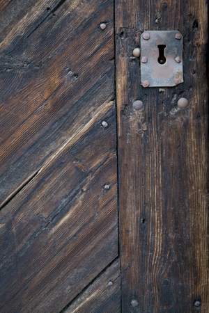 Old Keyhole in Wooden Door photo