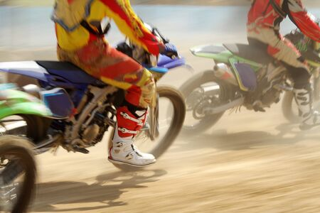 bicycle race: Motocross bikes racing in track