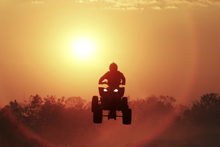 Silhouette ATV jump Stock Photo - 12682654