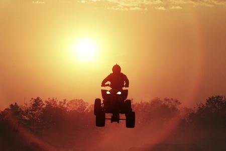 atv: Silhouette ATV jump