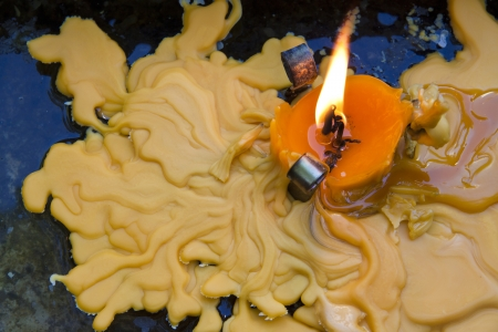 devotions: melting candle