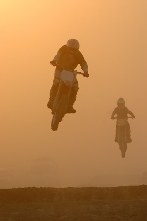 Motocross jump in dusty Stock Photo - 12682655