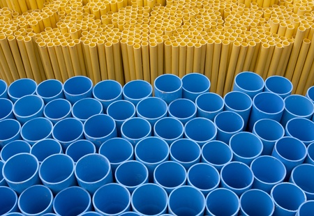 local supply: Blue and yellow pvc pipes Stock Photo