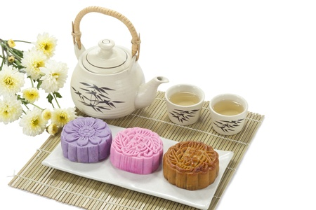 Three mooncake and tea isolated on white photo