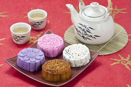 Four mooncake on red tablecloth