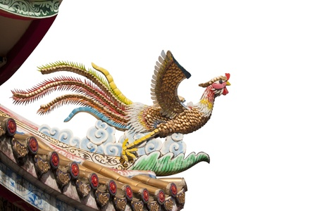 Chinese phoenix sculpture on temple roof isolated photo
