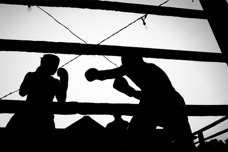 knockdown: Silhouette outdoor boxing fight