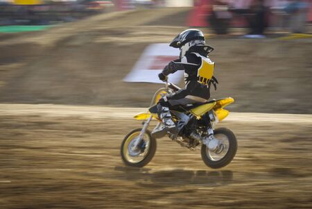 Motocross bikes racing in track photo
