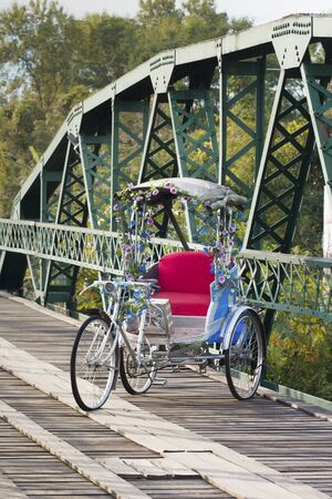 antique tricycle: Tricycle in old bridge