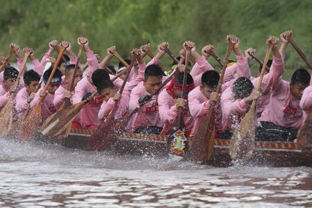 momentum: NAAN THAILAND - SEPTEMBER 26 :  Unidentified  boat  team actively in the Naan Boat race on September 26, 2009 in Naan, Thailand. Editorial