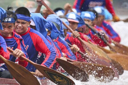 actively: NAAN THAILAND - SEP 26: Unidentified boat team actively in the Naan Boat race on September 26, 2009 in Naan, Thailand.