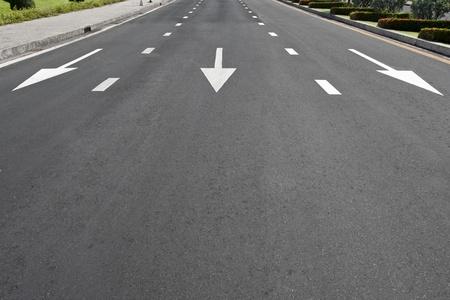 Traffic symbol on surface road photo