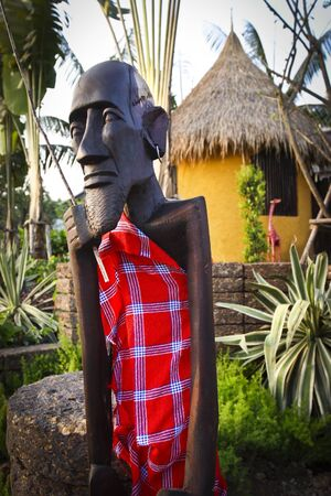Kenya Masai wood carving in village photo