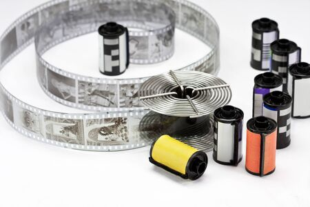 Old 35mm film and reel on a white background Stock Photo - 14603785