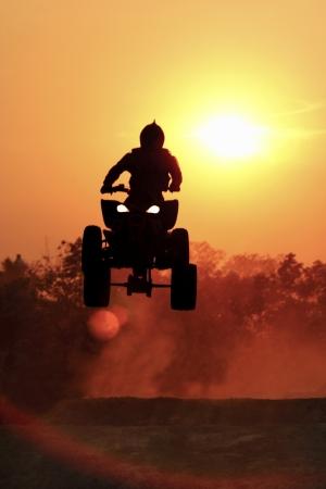 Silhouette ATV bike jump Stock Photo - 14732026