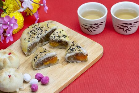 Moon cake with sesame topping and yolk inside photo