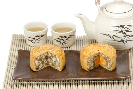 Moon cake with nuts and yolk inside photo