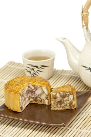 east asian culture: Moon cake with nuts and beans inside