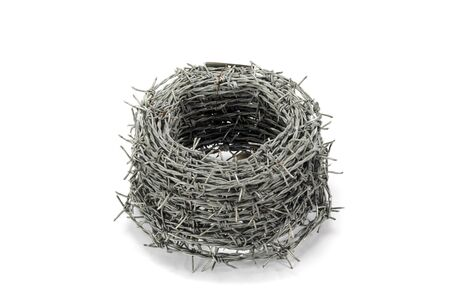barbed wire fence: A roll of barbed wire on white background