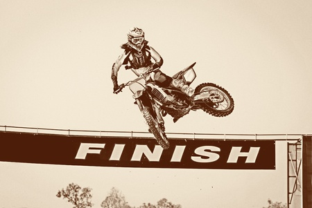 Motocross winner jump Stock Photo - 16404423