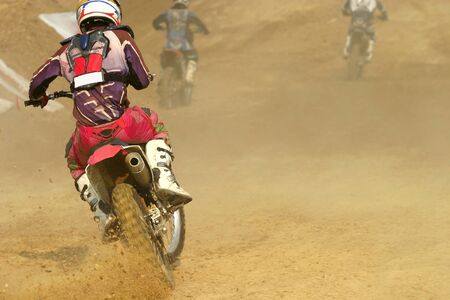 motocross bike increase speed in track photo