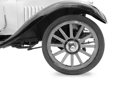 car body: Vintage tire and wood rim of old classic car