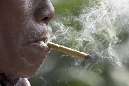 cheroot: Smoking cheroot , native cigarette in southeast asia