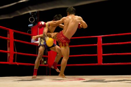 knockdown: Muay Thai fighters compete in a Thai boxing match