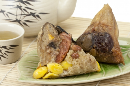 Rice dumplings or zongzi with tea  photo