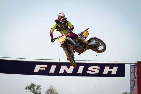 supercross: Red Motocross winner jump  Editorial