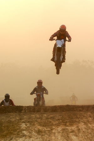 showoff: Motocross bike Jump in the sunset  Stock Photo