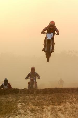 supercross: Motocross bike Jump in the sunset  Stock Photo