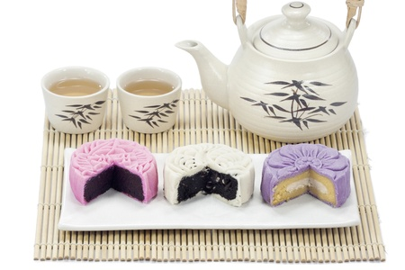 Three mooncake with tea.  photo
