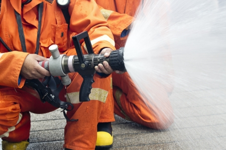 Firefighters spray water