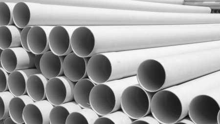 pvc: VC pipes stacked in construction site ,aspect ratio 16:9