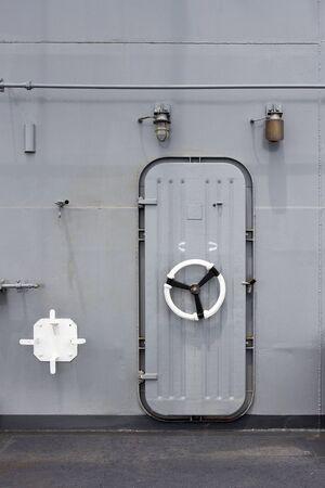 Iron ship door with lock wheel Stock Photo - 19623297
