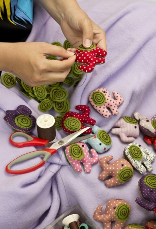 made by hand: Hand sewing and cloth dolls  Stock Photo