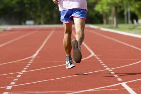 jogging track: Male running at a track and field stadium