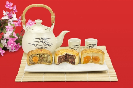 Moon cakes ,traditional chinese bakery on red background