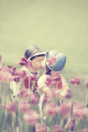 Two Kissing Dolls In Tulip Garden Stock Photo - 21697263