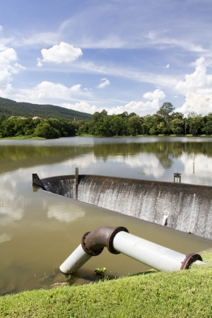 weir: Water supply pipe and dam  Stock Photo