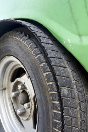 Blowout tire of old car photo