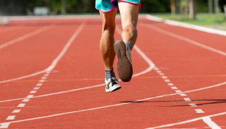 athlete running in track