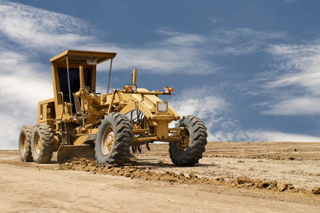 Motor grader working on road construction  photo