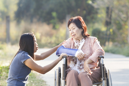 arms on chair: Young asian is taking care the senior woman ,Thailand