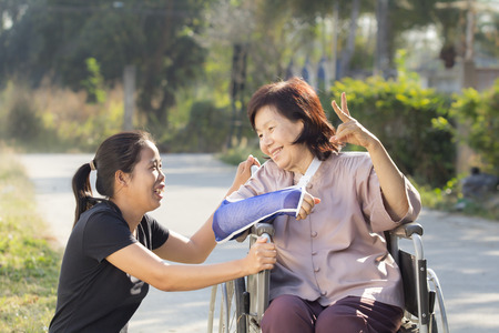 broken wrist: Young asian is taking care the senior woman ,Thailand